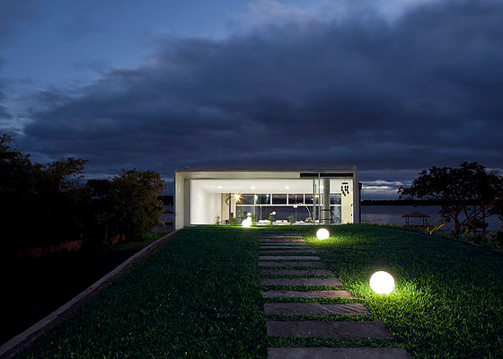 Green roof night view. Concrete shell in the background