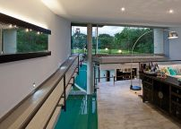 Ramp above the swimming pool on left and mezzanine on right